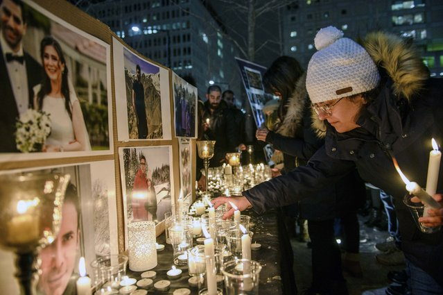 """Members of Montreal's Iranian community attend a vigil, Thursday, January 9, 2019 in downtown Montreal. It is """"highly likely"""" that Iran shot down the civilian Ukrainian jetliner that crashed near Tehran late Tuesday, killing all 176 people on board, U.S., Canadian and British officials declared Thursday. They said the fiery missile strike could well have been a mistake amid rocket launches and high tension throughout the region. (Photo by Andrej Ivanov/The Canadian Press via AP Photo)"""