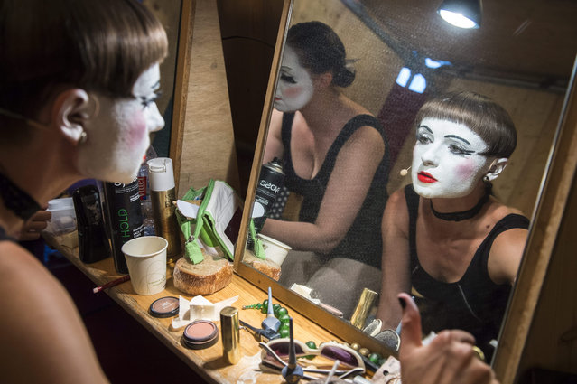 "A photo made available 07 August 2015 of members of the Ukrainian group ""Dakh Daughters Band"" preparing for their performance at the ""Seebuehne"" (lit: Lakeside stage) within the ""Zuercher Theater Spektakel"" (Zurich Theatre Spectacle) at the ""Landiwiese"" venue in Zurich, Switzerland, late 06 August 2015. The international theater and performing arts festival runs from 06 to 23 August 2015. (Photo by Dominic Steinmann/EPA)"
