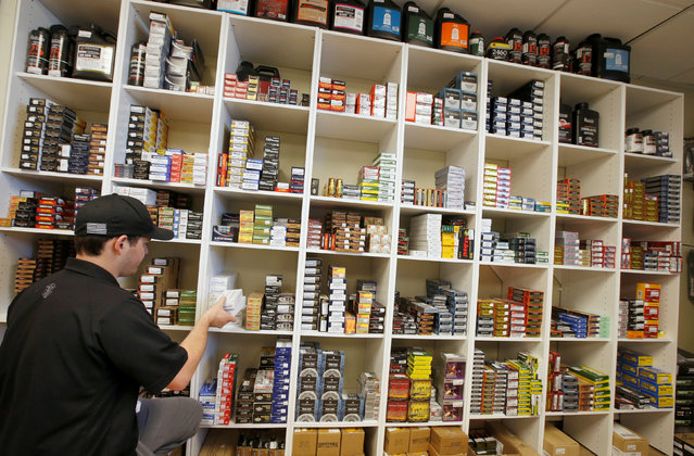 "Salesman, Ryan Martinez stocks a wall of ammunition at the ""Ready Gunner"" gun store in Provo, Utah, U.S., June 21, 2016. (Photo by George Frey/Reuters)"