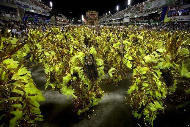 Revelers dance during the Beija Flor samba school parade at the Sambadrome in Rio de Janeiro