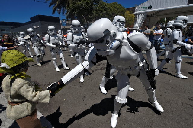 Persons wearing Star Wars costumes are seen during the Metropoli (Media Culture and Entertainment Festival) parade in Gijon, northern Spain July 3, 2016. (Photo by Eloy Alonso/Reuters)