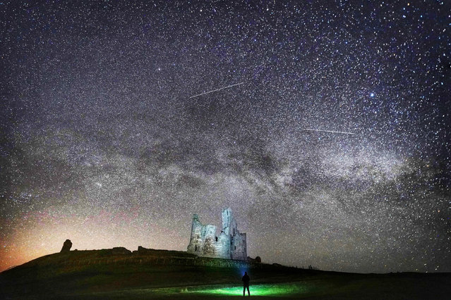 Dunstanburgh Castle in Northumberland, England taken showing the Milky Way on April 11, 2019. The picture is from a collection by PA news agency photographer Owen Humphreys showing some of the north east's best-loved landmarks by night. (Photo by Owen Humphreys/PA Images via Getty Images)