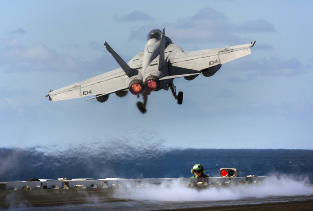 A July 14, 2017 supplied image from the Australian Defence Force of a United States Navy F/A-18E Super Hornet taking off from the flight deck of the USS Ronald Reagan during Exercise Talisman Saber 2017. (Photo by Reuters/Australian Defence Force)