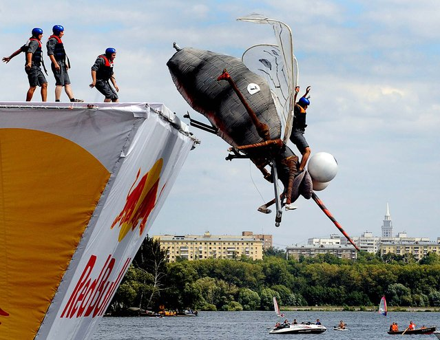 A competitor plunges into the water during the Red Bull Flugtag event in Moscow. (Photo by Natalia Kolesnikova/AFP)