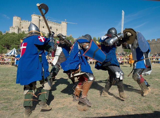 A knight of the Danish team, right, fights with a knight of the Quebec team during the International Medieval Combat at Belmonte castle, May 1, 2014, in Belmonte, Spain. (Photo by Denis Doyle/Getty Images)
