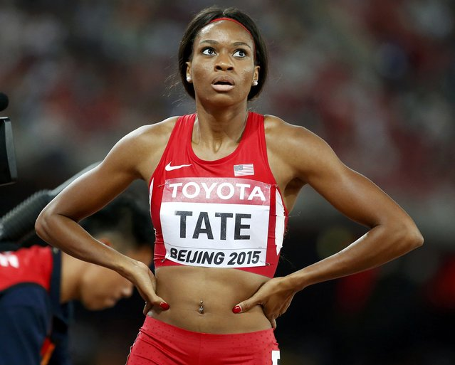 Cassandra Tate of U.S. looks at the scoreboard after winning the women's 400 metres hurdles semi-final during the 15th IAAF World Championships at the National Stadium in Beijing, China August 24, 2015. (Photo by Lucy Nicholson/Reuters)