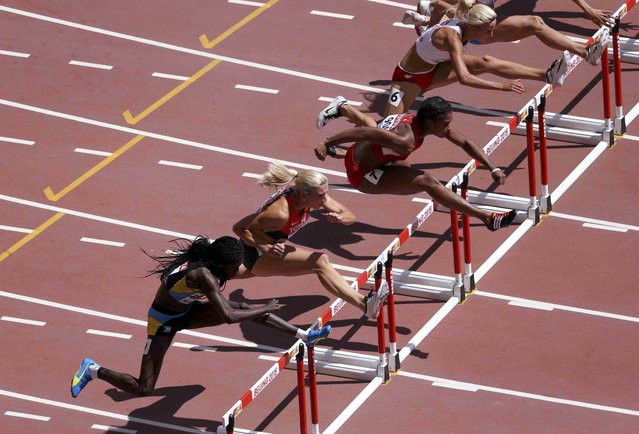 Athletes compete in the women's 100 metres hurdles heats during the 15th IAAF World Championships at the National Stadium in Beijing, China August 27, 2015. (Photo by Dylan Martinez/Reuters)