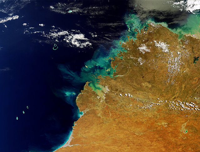 This is Western Australia's Kimberley Region. On the lower left are the Rowley Shoals coral reefs and on the upper-right is Lake Argyle, Australia's largest artificial lake. (Photo by The European Space Agency)