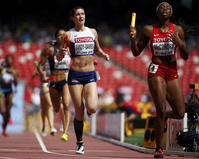 Seren Bundy-Davies of Britain (C) reacts after finishing second in the women's 4 x 400 metres relay heat during the 15th IAAF World Championships at the National Stadium in Beijing, China August 29, 2015. (Photo by Lucy Nicholson/Reuters)