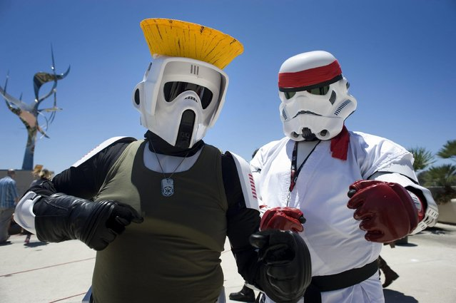 Convention goers dressed as altered Star Wars fictional characters pose for a photo outside Comic Con 2016 in San Diego, California, USA, 22 July 2016. (Photo by David Maung/EPA)