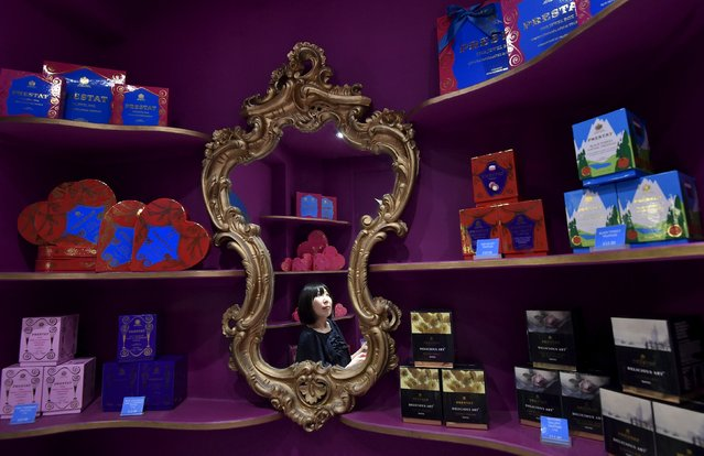 Manager Kaya Ueno is seen reflected in a mirror in Prestat chocolatiers in central London, Britain, August 19, 2015. Prestat, established in 1902, has a warrant as a chocolate supplier to Queen Elizabeth. (Photo by Toby Melville/Reuters)