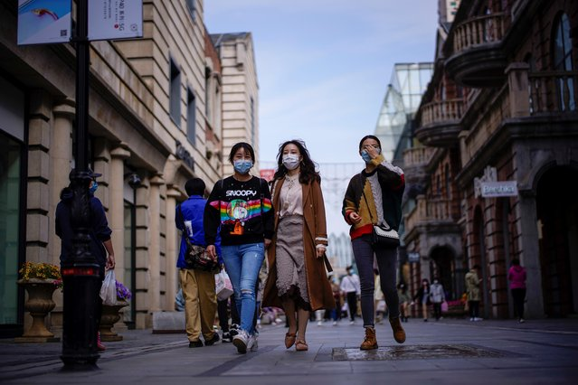 People wearing face masks are seen at a main shopping area after the lockdown was lifted in Wuhan, capital of Hubei province and China's epicentre of the novel coronavirus disease (COVID-19) outbreak, April 14, 2020. (Photo by Aly Song/Reuters)