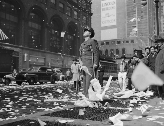 On May 8, 1945, on 42Nd Street in New York. Injured sergeant Arthur Moore from Buffalo stood still while contemplating the general sense of euphoria as the end of the war was announced.  (Photo by Keystone-France/Gamma-Keystone via Getty Images)