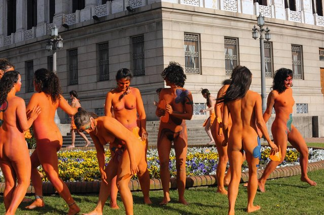 Women with body paintings take part in a demo in favour of the legalization of abortion in front of the Congress building in Montevideo on September 25, 2012. The Congress is voting a law project which would decriminilize the interruption of pregnancy under certain conditions, including obliging women to set out before a tribunal the reasons for the abortion.  AFP PHOTO/Miguel ROJO        (Photo credit should read MIGUEL ROJO/AFP/GettyImages)