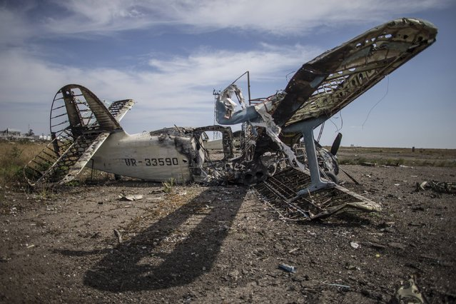 A burnt-out plane is seen at the destroyed airport in Luhanks, eastern Ukraine, September 14, 2014. (Photo by Marko Djurica/Reuters)