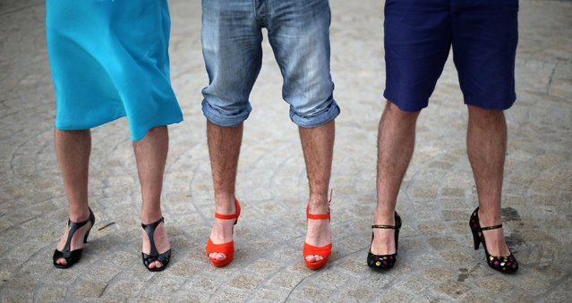 Fundraisers take part in the Walk a Mile in Her Shoes charity event at the Point Village in Dublin on September 13, 2014, where men were asked to do a mile long walk in women's footwear to raise funds for Concern Worldwide and Women's Aid. (Photo by Niall Carson/PA Wire)