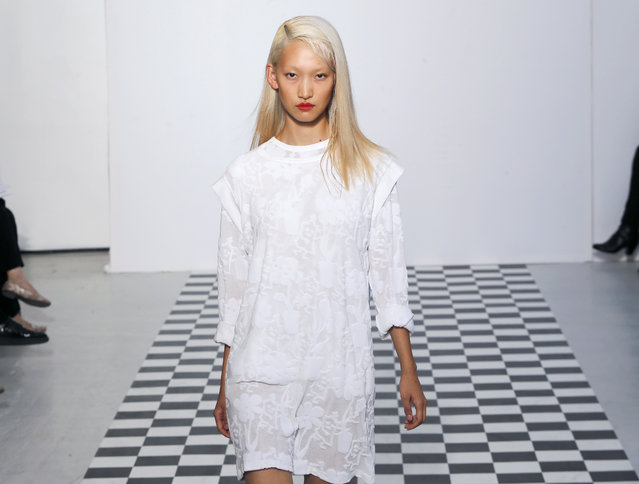 A model presents a creation by french fashion designers Ophelie Klere and Francois Alary for Devastee's Spring/Summer 2015 ready-to-wear fashion collection, presented in Paris, Tuesday, September 23, 2014. (Photo by Jacques Brinon/AP Photo)