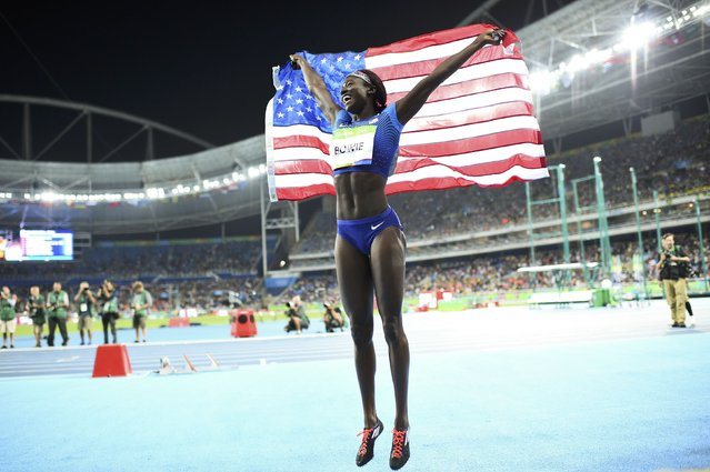 2016 Rio Olympics, Athletics, Final, Women's 100m Final, Olympic Stadium, Rio de Janeiro, Brazil on August 13, 2016. Tori Bowie (USA) of USA celebrates. (Photo by Dylan Martinez/Reuters)