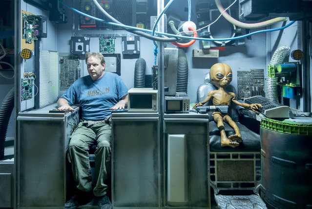 A UFO enthusiast who found himself locked in the iconic Roswell museum has shared the pictures he took with aliens to pass the time. Chris Burton, from the U.K., had dreamed of visiting Roswell, N.M., since he was a child but was stunned when he found himself locked in the International UFO Museum and Research Center during a recent trip. The 42-year-old used the unique opportunity to get interactive with the usually out of bounds exhibits and set up some funny snaps with the extraterrestrials – posing for a beer with one alien and taking a nap with another. Here: Chris has fun with one of the exhibits. (Photo by Chris Burton/Caters News Agency)