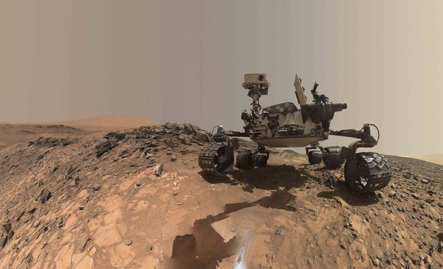 """A low-angle self-portrait of NASA's Curiosity Mars rover showing the vehicle at the site from which it reached down to drill into a rock target call """"Buckskin"""" is show in this handout photo taken August 5, 2015 and provided by NASA October 8, 2015. The MAHLI camera on Curiosity's robotic arm took multiply images that were stitched together into the """"selfie"""" according to NASA. (Photo by Reuters/NASA/JPL-Caltech/MSSS)"""