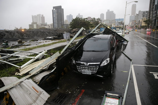 A genneral view shows debris that fell on a car after strong winds and rain from Super Typhoon Meranti in Kaohsiung, southern Taiwan, 14 September 2016. (Photo by Ritchie B. Tongo/EPA)