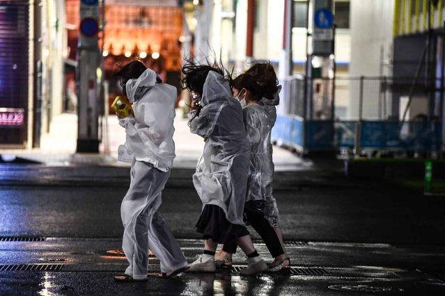 Women walk in heavy rain as Typhoon Haishen hits Kagoshima, Kagoshima prefecture on September 6, 2020. Typhoon Haishen began to lash southern Japan on September 6, with officials warning it could bring record rainfall and winds strong enough to snap power line poles and flip cars. (Photo by Charly Triballeau/AFP Photo)