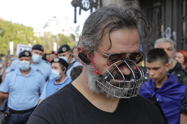 A man wears a muzzle during a protest in Bucharest, Romania, Saturday, September 19, 2020. (Photo by Vadim Ghirda/AP Photo)
