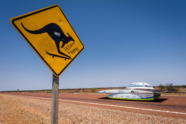 The Punch Powertrain Solar Team car from Belgium competes during the fourth day of the 2015 World Solar Challenge in Coober Pedy, Australia, on Wednesday, October 21, 2015. 45 Solar cars from 25 different countries participate in a 3,000 km race from Darwin to Adelaide. (Photo by Geert Vanden Wijngaert/AP Photo)