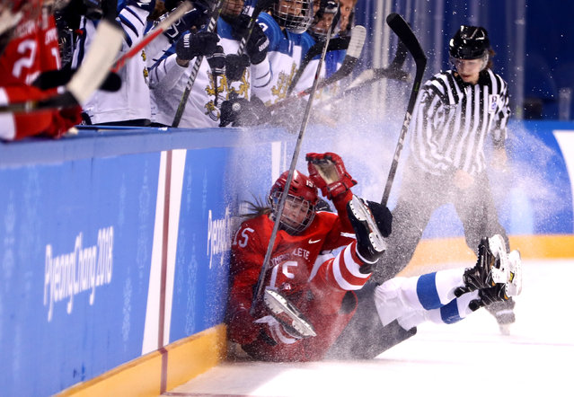 Valeria Pavlova #15 of Olympic Athlete from Russia and Minnamari Tuominen #15 of Finland collide in the first period during the Women's Ice Hockey Bronze Medal game on day twelve of the PyeongChang 2018 Winter Olympic Games at Kwandong Hockey Centre on February 21, 2018 in Gangneung, South Korea. (Photo by Jamie Squire/Getty Images)
