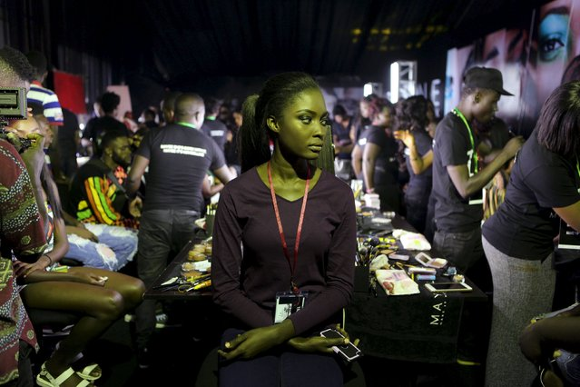 A model waits for a make-up artist at the runway show at Lagos Fashion and Design Week in Lagos, Nigeria, October 29, 2015. (Photo by Joe Penney/Reuters)
