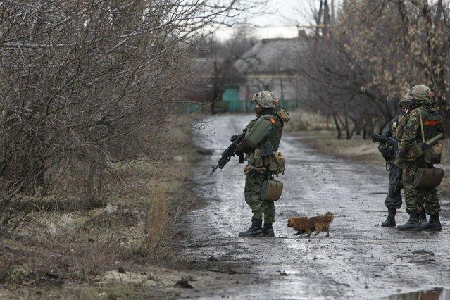 Ukrainian servicemen patrol an area near the eastern Ukrainian town of Debaltseve in Donetsk region, December 24, 2014. (Photo by Valentyn Ogirenko/Reuters)