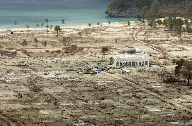 In this January 30, 2005 file photo, an aerial view shows the Rahmatullah Lampuuk mosque in the village of Lhoknga, near Banda Aceh, Indonesia. Friday marks the 10th anniversary of one of the deadliest natural disasters in world history: a tsunami, triggered by a massive earthquake off the Indonesian coast, leaving more than 230,000 people dead in 14 countries and causing about $10 billion in damage. (Photo by Greg Baker/AP Photo)