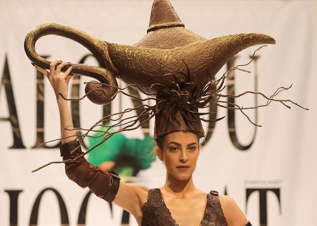 A model displays a dress made out of chocolate during a fashion show with chocolate dresses on the occasion of Beirut Cooking Festival on November 12, 2015 in the Lebanese capital. (Photo by Joseph Eid/AFP Photo)
