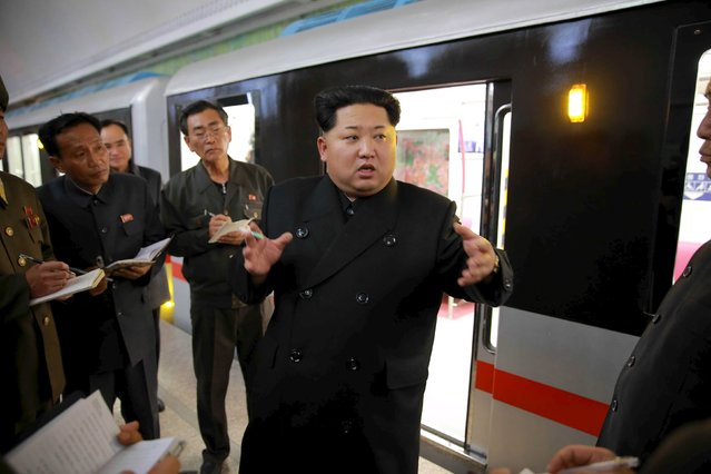 North Korean leader Kim Jong Un looks around a newly manufactured subway train at a station in Pyongyang, in this undated photo released by North Korea's Korean Central News Agency (KCNA) on November 20, 2015. (Photo by Reuters/KCNA)