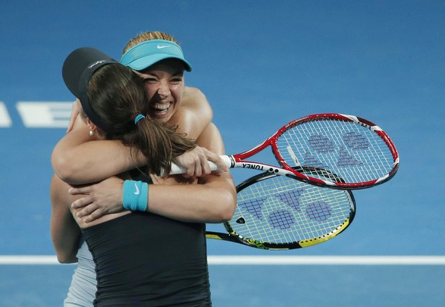 Martina Hingis of Switzerland and Sabine Lisicki (facing camera) of Germany embrace after winning the women's doubles final match at the Brisbane International tennis tournament in Brisbane, January 10, 2015. (Photo by Jason Reed/Reuters)