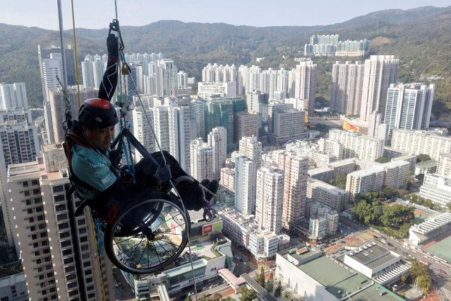 Lai Chi-wai, a paraplegic climber, attempts to climb the 320-metre tall Nina Tower using only his upper body strength, in Hong Kong, China January 16, 2021. (Photo by Tyrone Siu/Reuters)