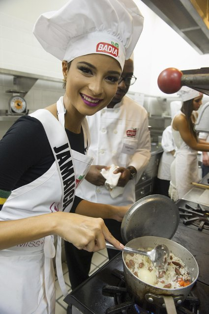 Miss Jamaica 2014 Kaci Fennell prepares a dish prepares a dish for a cook-off at the Chaplin School of Hospitality and Tourism during the 63rd annual Miss Universe Pageant in Miami, Florida in this January 13, 2015 handout photo provided by Miss Universe Organization. (Photo by Reuters/Miss Universe Organization)