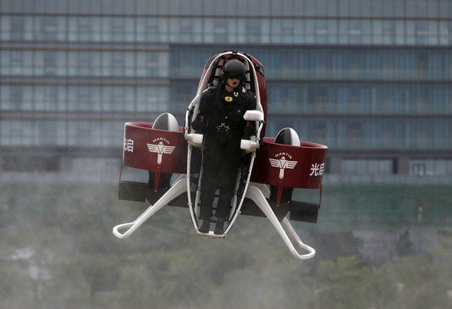 Michael Read, director of Flight Operations from New Zealand-based Martin Aircraft Company, flies a Martin Jetpack during a demonstration at a water park in Shenzhen, China December 6, 2015. KuangChi Science Ltd, a Hong Kong-listed Chinese company and investor of Martin Aircraft, will sell the flying machine in mainland China for 1.6 million yuan ($249,902), according to the company. (Photo by Bobby Yip/Reuters)