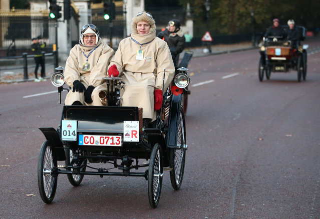 Participants drive their 1898c Benz past Buckingham Palace during the annual London to Brighton veteran car run in London, Britain November 6, 2016. (Photo by Neil Hall/Reuters)