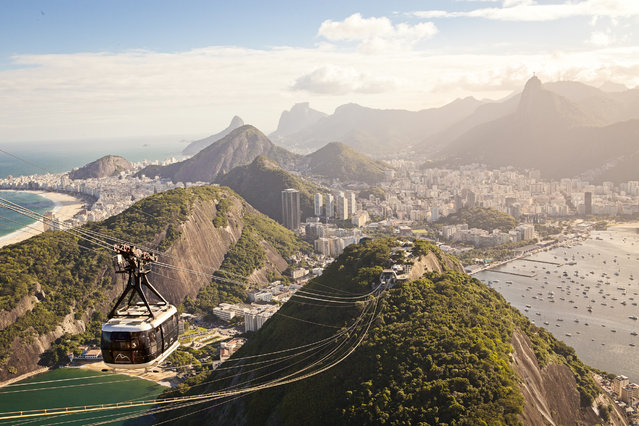 """Rio de Janeiro"". Rio de Janeiro, Cidade Maravilhosa. After spending two months in this beautiful city, with carioca people, samba, and lots of caipirinha, finally there was a perfect day to go up to Sugarloaf mountain and take this picture. (Photo and caption by Ignazio Sciacca/National Geographic Traveler Photo Contest)"