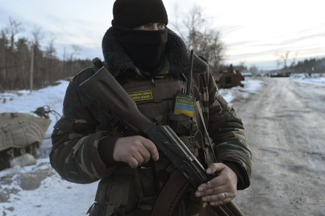 A Ukrainian serviceman stands guard at his position in the village of Luhanska, Luhansk region January 24, 2015. (Photo by Oleksandr Klymenko/Reuters)