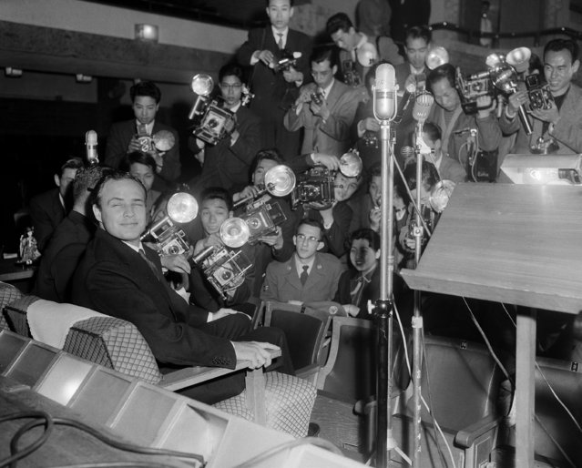 "Actor Marlon Brando, who arrived in Japan, April 3, 1956 for the premiere of ""Guys and Dolls"" and the filming of ""Teahouse of the August Moon"" in which he will star. Brando held a press conference that turned into a photo session at the Imperial Hotel in Downtown Tokyo, April 4, 1956. (Photo by AP Photo)"
