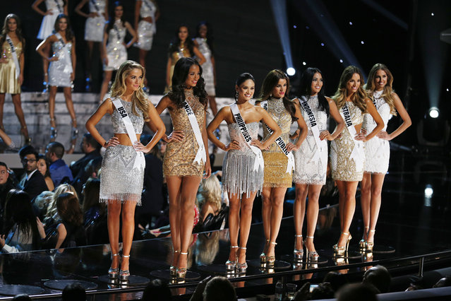 Seven of the final 15 contestants pose on stage at the Miss Universe pageant Sunday, December 20, 2015, in Las Vegas. (Photo by John Locher/AP Photo)