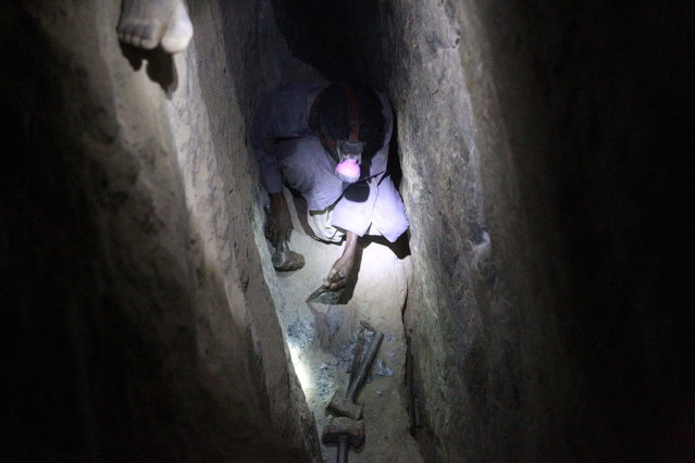 A gold mine worker looks for gold inside a local mine in Al-Ibedia locality at River Nile State, July 30, 2013. (Photo by Mohamed Nureldin Abdallah/Reuters)