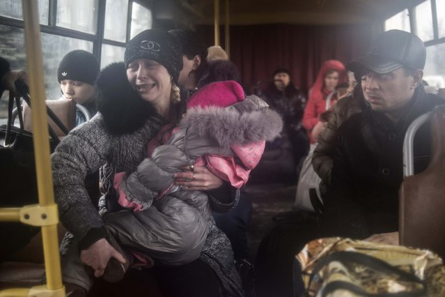 People sit inside a bus before the departure, as they flee due to the military conflict, in Debaltseve, February 3, 2015. (Photo by Sergey Polezhaka/Reuters)