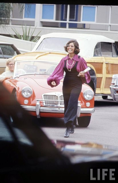 High schooler Lenore Reday stops traffic while wearing a bell-bottomed jump suit in Newport Beach, Calif., 1969. (Photo by Arthur Schatz/Time & Life Pictures/Getty Images)