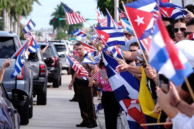 Cuban Americans in Miami's Little Havana celebrate the death of longtime Cuban leader Fidel Castro on November 26, 2016. (Photo by Gaston De Cardenas/AFP Photo)