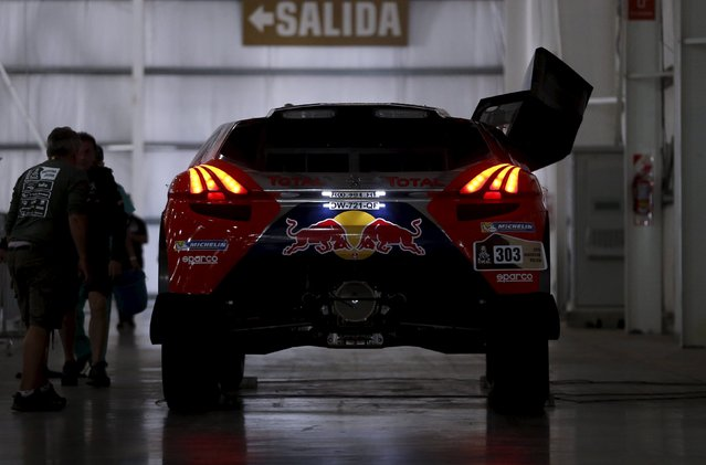 The Peugeot vehicle of driver Carlos Sainz of Spain is seen at the technical verification area ahead of the Dakar Rally 2016 in Buenos Aires, Argentina, January 1, 2016. (Photo by Marcos Brindicci/Reuters)