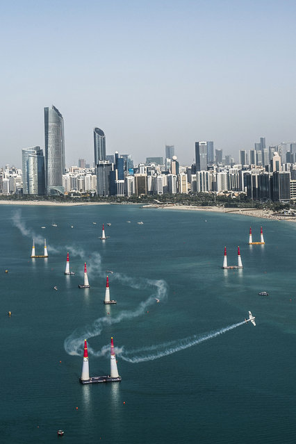 In this photo provided by Predrag Vuckovic via Global-Newsroom, Michael Goulian of the United States performs during the qualifying of the first stage of the Red Bull Air Race World Championship in Abu Dhabi, United Arab Emirates, Friday, February 13, 2015. (Photo by Predrag Vuckovic/AP Photo/Global-Newsro