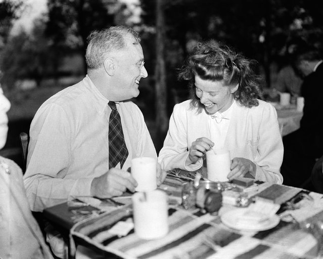 President Franklin D. Roosevelt, left, and actress Katharine Hepburn at the president's Hyde Park, N.Y., estate on September 22, 1940. Nearly a score of authors and playwrights were guests of the president and they pledged their support to a third term for the chief executive. (Photo by Henry Griffin/AP Photo)